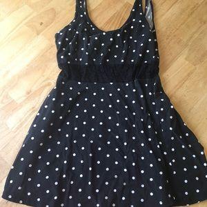 Black polka dot dress with lace cutout sleeveless